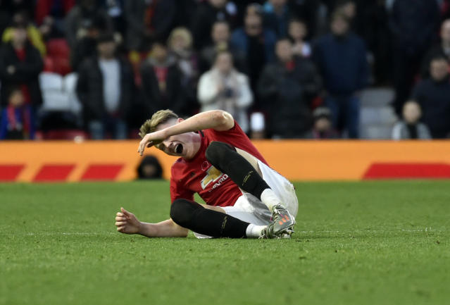 Manchester United's Scott McTominay lays on the pitch after being fouled during the English Premier League soccer match between Manchester United and Brighton and Hove Albion, at the Old Trafford stadium in Manchester, England, Sunday, Nov. 10, 2019. (AP Photo/Rui Vieira)