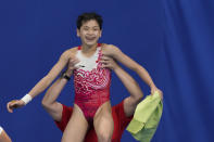 Quan Hongchan of China celebrates after competing in women's diving 10-meter platform final at the 2020 Summer Olympics, Thursday, Aug. 5, 2021, in Tokyo, Japan. (AP Photo/Alessandra Tarantino)