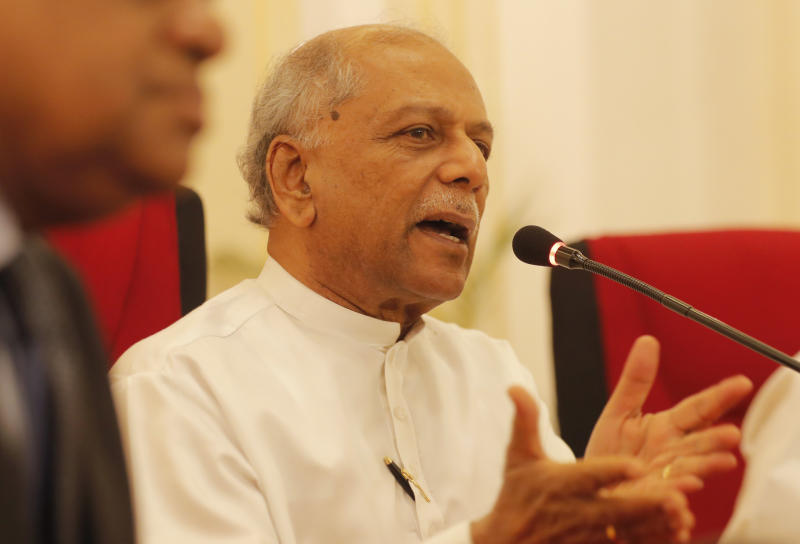 Sri Lankan Foreign Minster Dinesh Gunawardena speaks to media in Colombo, Sri Lanka, Wednesday, Dec. 4, 2019. Sri Lanka's foreign minister says the government has rejected a request from the Swiss Embassy to allow one of its employees to be flown out for medical treatment after a group allegedly abducted and threatened her to disclose embassy information. (AP Photo/Eranga Jayawardena)