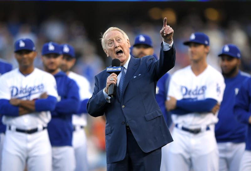 Vin Scully, seen here in May, says he'll only return to Dodger Stadium as a fan for the World Series. (AP)