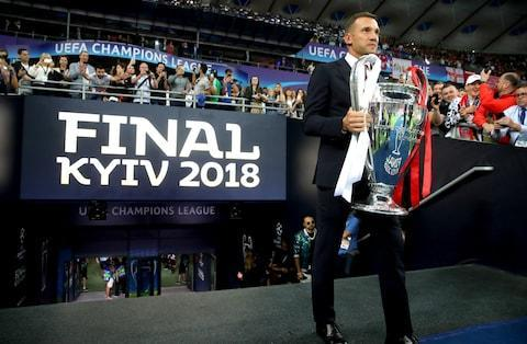 <span>Andriy Shevchenko brings the trophy out to the side of the pitch</span> <span>Credit: Alexander Hassenstein - UEFA </span>