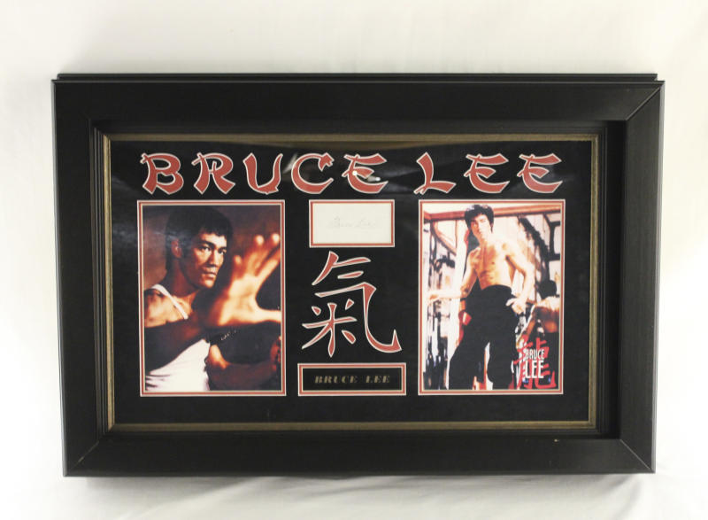 This undated photo provided by Texas-based Gaston & Sheehan Auctioneers, Inc. shows an autographed Bruce Lee collectible that belonged to former Illinois Congressman Jesse Jackson Jr. It is among the items the U.S. Marshals Service started selling in an online auction Tuesday, Sept. 17, 2013, in its attempt to recoup part of the $750,000 in campaign funds the Chicago Democrat and his wife illegally spent. Both were handed prison terms last month. The auction runs through Sept. 26. (AP Photo/Courtesy Gaston & Sheehan Auctioneers, Inc.)