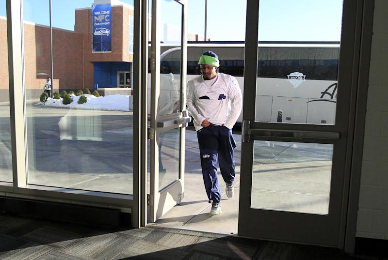 Seattle Seahawks running back Marshawn Lynch arrives for NFL football practice Wednesday, Jan. 29, 2014, in East Rutherford, N.J. The Seahawks and the Denver Broncos are scheduled to play in the Super Bowl XLVIII football game Sunday, Feb. 2, 2014. (AP Photo/Jeff Roberson)