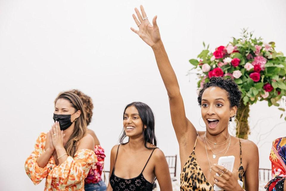 """What's a bridal shower without games? Here my friends Ashley Nguyen, Elizabeth Grullon, and Stella Wilson are taking a stab at guessing """"where the photo took place."""""""