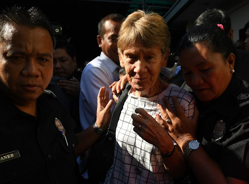 Australian nun Patricia Fox was escorted by immigration officers after leaving a detention facility in April