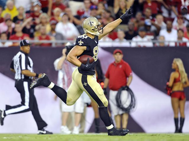 New Orleans Saints tight end Jimmy Graham (80) celebrates as he scores on a 56-yard touchdown reception from quarterback Drew Brees against the Tampa Bay Buccaneers during the first quarter of an NFL football game on Sunday, Sept. 15, 2013, in Tampa, Fla. (AP Photo/Brian Blanco)