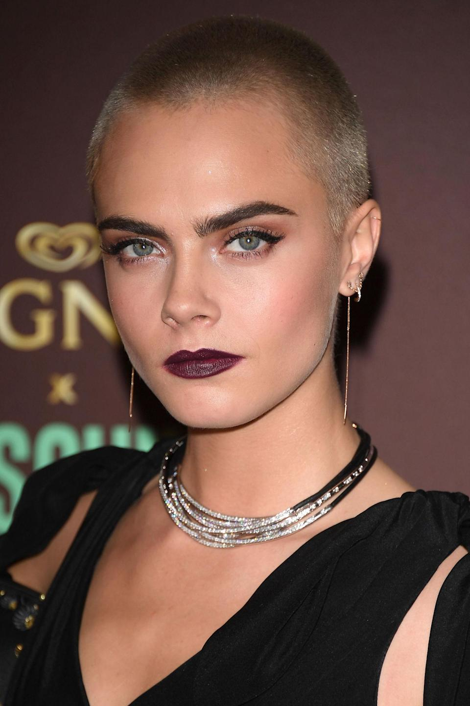 <p>Never one to disappoint, Delevingne chose a dark berry lip, subtle highlight and emphasised her brows while walking the red carpet.</p>