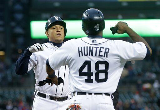 Detroit Tigers' Miguel Cabrera is congratulated by teammate Torii Hunter after hitting a two-run home run during the first inning of a baseball game against the Minnesota Twins in Detroit, Thursday, May 23, 2013. (AP Photo/Carlos Osorio)
