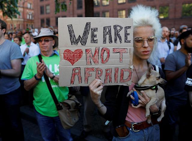 <p>A woman holds a placard as they take part in a vigil for the victims of an attack on concert goers at Manchester Arena, in central Manchester, Britain on May 23, 2017. (Peter Nicholls/Reuters) </p>