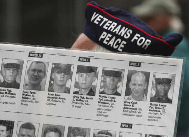 <p>David Eldredge, a veteran of the Korean War and supporter of the Veterans for Peace organization, holds a placard showing U.S. troops who have died in Iraq during a Veterans Day protest against the U.S.-led military occupation of Iraq, Nov. 11, 2003, in Philadelphia. (Photo: Jacqueline Larma/AP) </p>