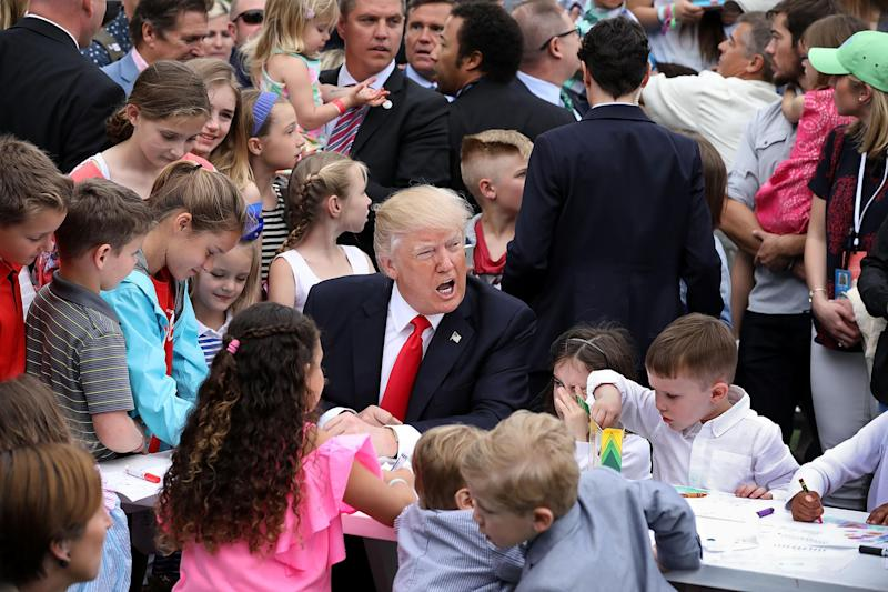 President surrounded by children at the Easter Egg roll event: Getty