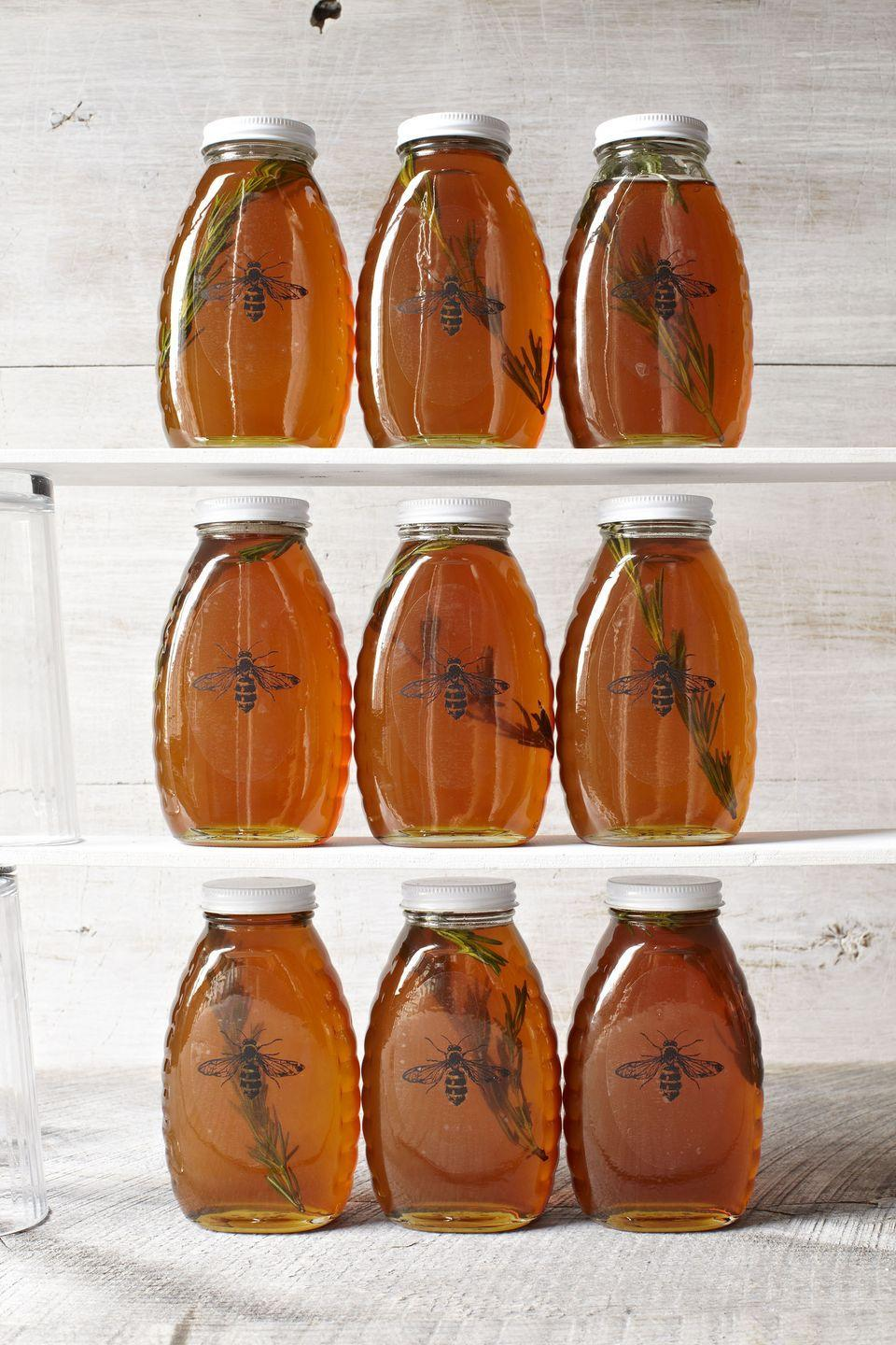 """<p>For an inspired upgrade to your standard jar of the good stuff, try infusing it with a few sprigs of rosemary—or any favorite herb.</p><p><strong><a href=""""https://www.countryliving.com/food-drinks/recipes/a6162/rosemary-honey-recipe-clv1212/"""" rel=""""nofollow noopener"""" target=""""_blank"""" data-ylk=""""slk:Get the recipe"""" class=""""link rapid-noclick-resp"""">Get the recipe</a>.</strong></p>"""