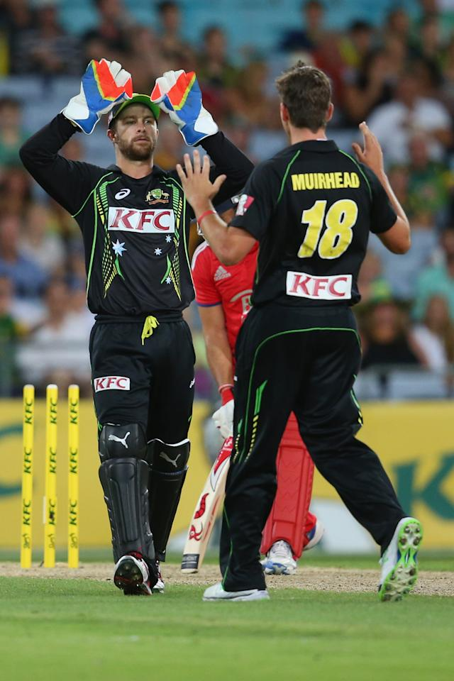 SYDNEY, AUSTRALIA - FEBRUARY 02:  Matthew Wade and James Muirhead of Australia celebrate the wicket of Tim Bresnan of England during game three of the International Twenty20 series between Australia and England at ANZ Stadium on February 2, 2014 in Sydney, Australia.  (Photo by Mark Kolbe/Getty Images)