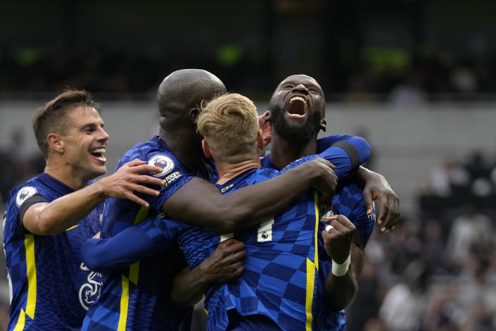 Chelsea's Antonio Rudiger, right, celebrates after scoring his side's third goal during the English Premier League soccer match between Tottenham Hotspur and Chelsea at the Tottenham Hotspur Stadium in London, England, Sunday, Sep. 19, 2021. (AP Photo/Matt Dunham)