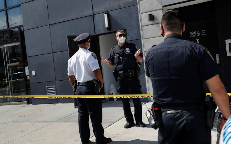 NYPD officers speak at crime scene where Fahim Saleh, co-founder/CEO of Gokada, was found dead at the apartment building in New York City - SHANNON STAPLETON/Reuters