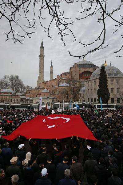 Backdropped by Hagia Sophia - a Byzantine-era cathedral that was turned into a mosque and now serves as a museum, demonstrators protest against the mosque attacks in New Zealand, in Istanbul, Saturday, March 16, 2019. The demonstrators - mostly members of Islamic-leaning civil society groups - called for the symbolic edifice to be reconverted into a mosque. (AP Photo/Lefteris Pitarakis)