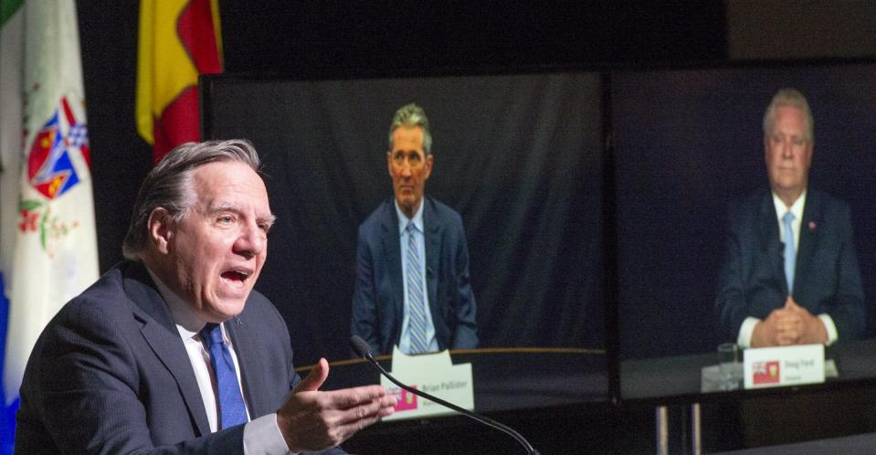 "<span class=""caption"">Québec Premier François Legault chairs a premiers virtual news conference as premiers Brian Pallister, Manitoba, and Doug Ford, Ontario, are seen on screen on March 4, 2021 in Montréal. </span> <span class=""attribution""><span class=""source"">THE CANADIAN PRESS/Ryan Remiorz</span></span>"