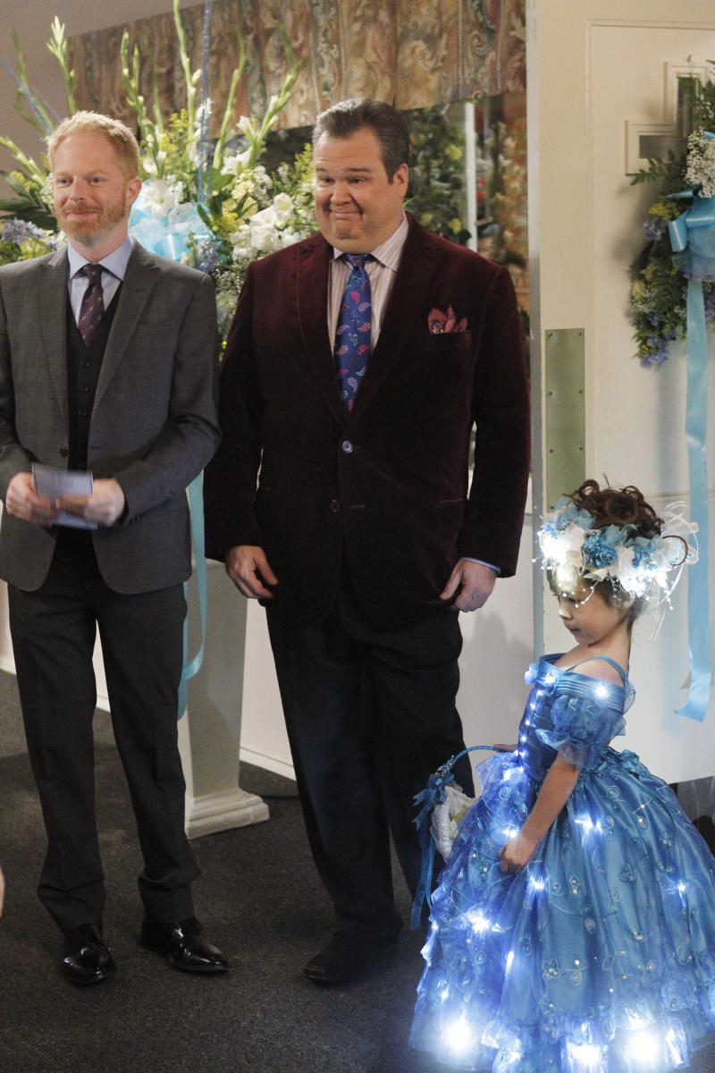 "In this image released by ABC, from left, Jesse Tyler Ferguson portraying Mitchell Pritchett, and Eric Stonestreet portraying Cameron Tucker are shown with Aubrey Anderson-Emmons, who plays their adopted daughter Lily in a scene from ""Modern Family,"" airing Wednesday, Jan. 18, 2012 at 9 p.m. EST on ABC. A group opposed to the use of profanity is protesting Wednesday's episode of ""Modern Family,"" in which the character Lily is shown, but not heard, using an expletive. (AP Photo/ABC, Peter ""Hopper"" Stone)"