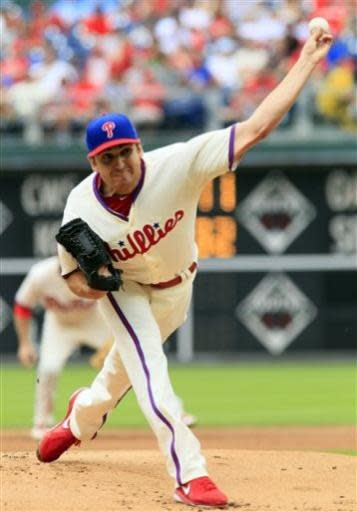 Philadelphia Phillies starting pitcher John Lannan delivers during the first inning of a baseball game with the New York Mets, Sunday, June 23, 2013, in Philadelphia. (AP Photo/Tom Mihalek)