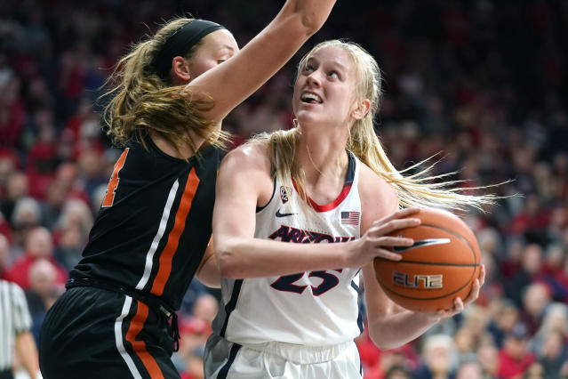 Arizona forward Cate Reese (25) drives on Oregon State forward Taylor Jones during the second half of an NCAA college basketball game Friday, Jan. 10, 2020, in Tucson, Ariz. Oregon State won 63-61. (AP Photo/Rick Scuteri)