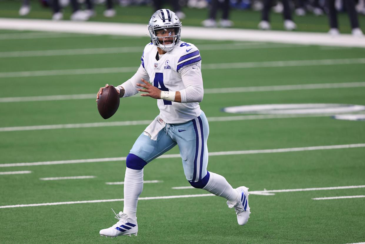 ARLINGTON, TEXAS - OCTOBER 11:  Dak Prescott #4 of the Dallas Cowboys attempts a pass against the New York Giants during the second quarter at AT&T Stadium on October 11, 2020 in Arlington, Texas. (Photo by Tom Pennington/Getty Images)