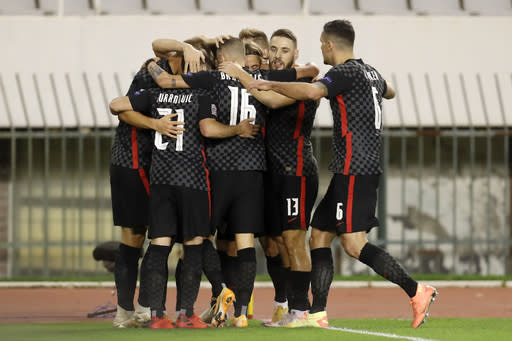 Croatia players celebrate after scoring the opening goal during the UEFA Nations League soccer match between Croatia and Portugal at the Poljud stadium in Split, Croatia, Tuesday, Nov. 17, 2020. (AP Photo/Darko Bandic)