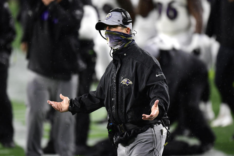 Ravens coach John Harbaugh will have a shorthanded team for Tuesday's game at Pittsburgh. (Photo by Billie Weiss/Getty Images)