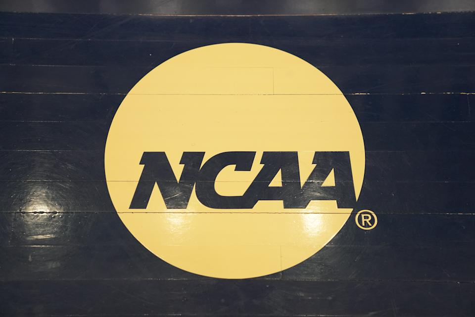The NCAA logo on the floor during a Atlantic 10 Women's Basketball Tournament
