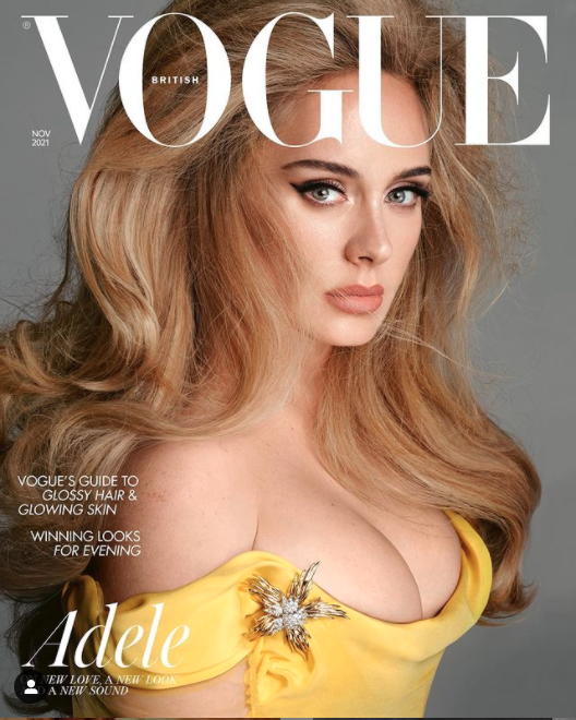 British pop singer Adele wearing a yellow off-the-shoulder dress on the cover of British Vogue November 2021