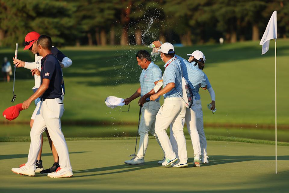 CT Pan (centre) is congratulated on winning bronze in a playoff (Getty Images)
