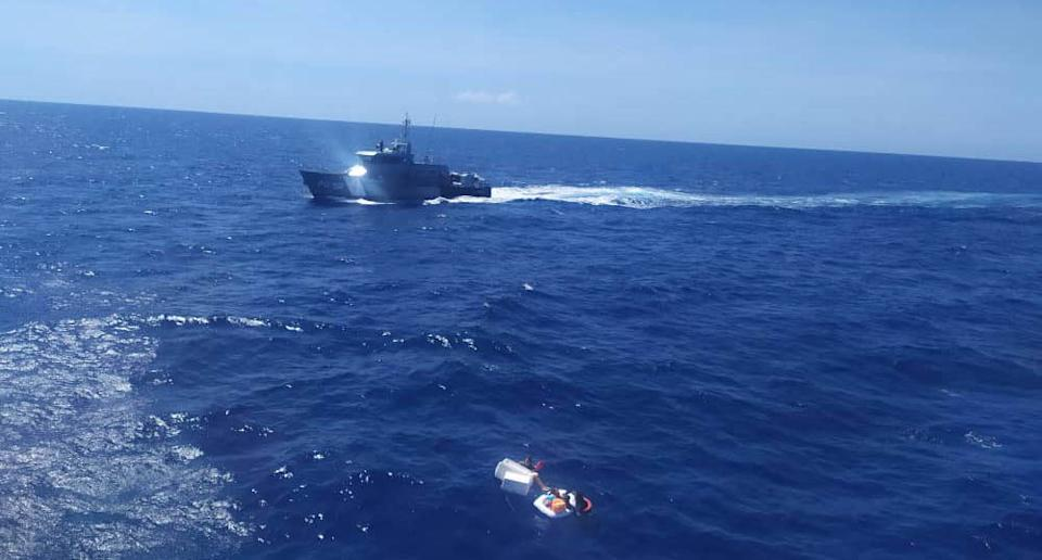 A photo taken by rescuers who found the two children clinging to remains of the vessel. Source: Twitter/inea_venezuela