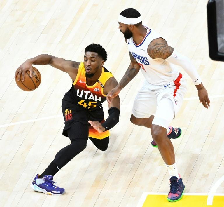 Utah Jazz forward Donovan Mitchell dribbles around Los Angeles Clippers Marcus Morris in the opening game of the Western Conference second-round playoff series in Salt Lake City