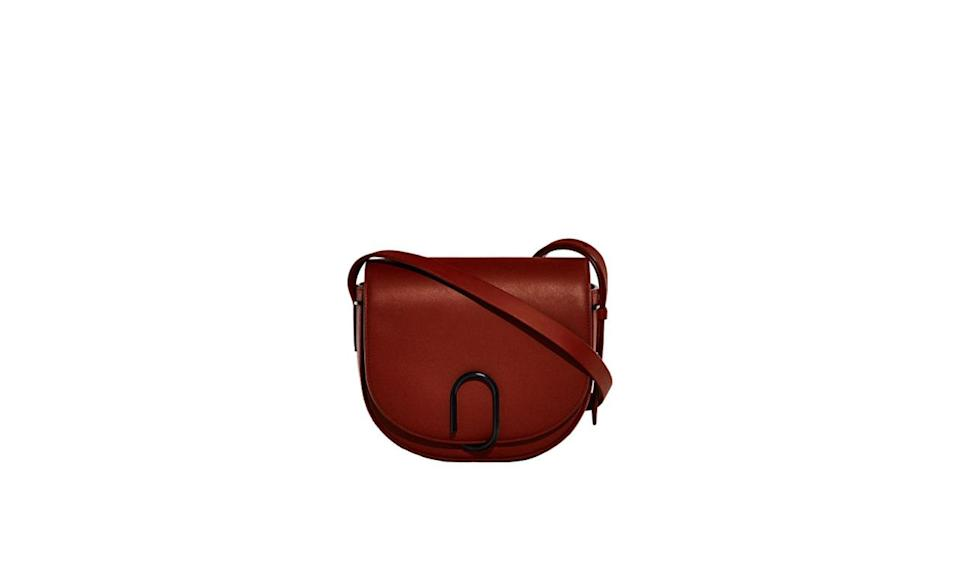 "<p>Phillip Lim's saddle bag in brick is perfect for every scenario this fall. </p><p>3.1 Phillip Lim Alix Saddle Crossbody, $950, <a href=""https://www.31philliplim.com/shop/alix-saddle-crossbody-2723.html"" rel=""nofollow noopener"" target=""_blank"" data-ylk=""slk:31philliplim.com"" class=""link rapid-noclick-resp"">31philliplim.com</a><b><br></b></p>"