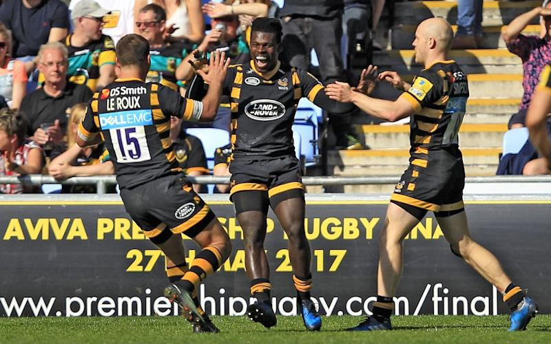 Christian Wade of Wasps (centre) celebrates scoring his side's second try - Rex Features