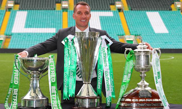 Brendan Rodgers with the three trophies Celtic have won this season in the club's second domestic clean sweep in succession.