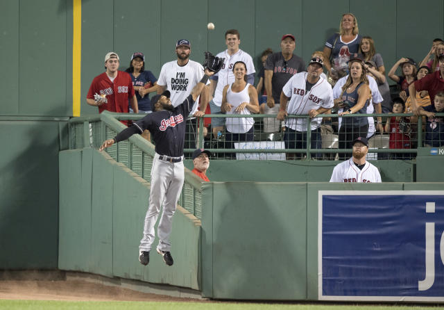 Indians outfielder Austin Jackson went over the wall to make this excellent catch. (Getty Images)