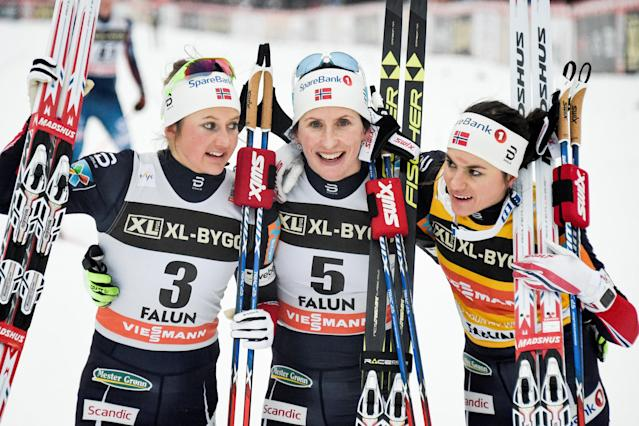 Marit Bjorgen (center), Ingvild Flugstad Ostberg (left) and Heidi Weng have helped Norway dominate the Winter Games so far. (Reuters)