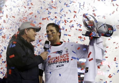 New England Patriots quarterback Tom Brady holds up the Lamar Hunt Trophy as he is interviewed after the AFC Championship Game against the Indianapolis Colts. REUTERS/David Butler II-USA TODAY Sports