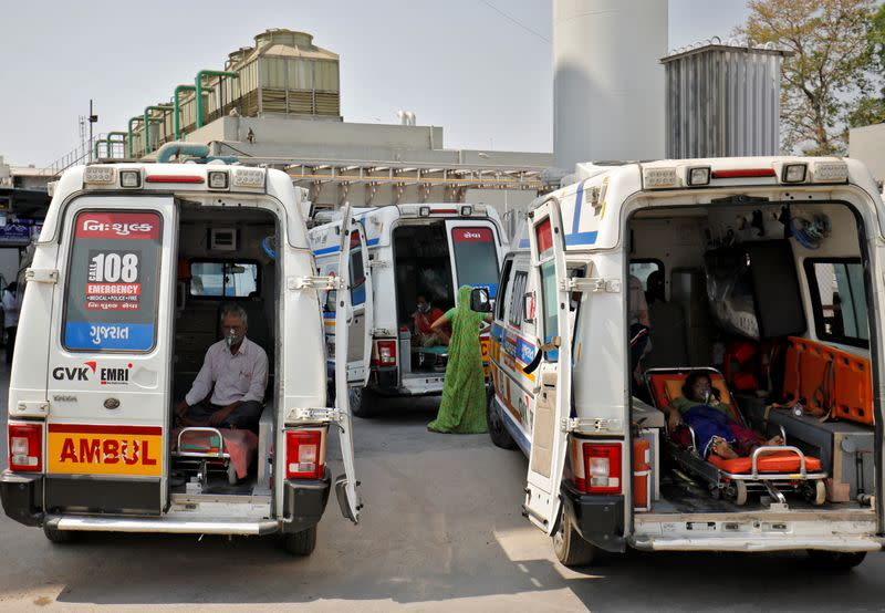 Patient wait inside ambulances in a queue to enter a COVID-19 hospital, in Ahmedabad