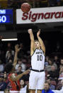 Wofford guard Nathan Hoover (10) shoots over VMI guard Bubba Parham (3) the second half of an NCAA college basketball game for the Southern Conference basketball tournament championship, Saturday, March 9, 2018, in Asheville, N.C. Wofford won 99-72. (AP Photo/Kathy Kmonicek)