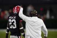 Georgia coach Kirby Smart, left, talks to defensive back Mark Webb (23) during the first half of the team's NCAA college football game against Mississippi State, Saturday, Nov. 21, 2020, in Athens, Ga. (AP Photo/Brynn Anderson)