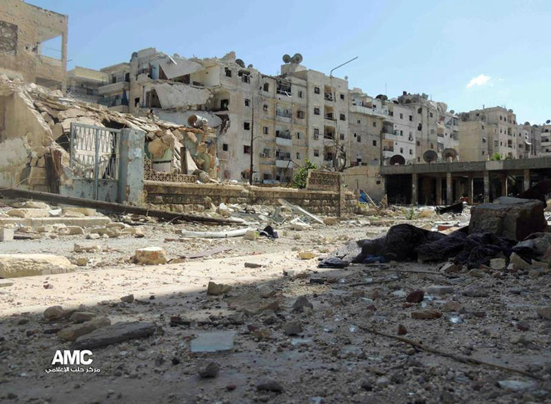 This citizen journalism image provided by Aleppo Media Center AMC which has been authenticated based on its contents and other AP reporting, shows damaged buildings during battles between the rebels and the Syrian government forces, in Aleppo, Syria, Thursday, June 6, 2013. An Austrian defense ministry official says Syrian rebels have captured a crossing point along a ceasefire line patrolled by U.N. troops between Syria and Israel. (AP Photo/Aleppo Media Center AMC)