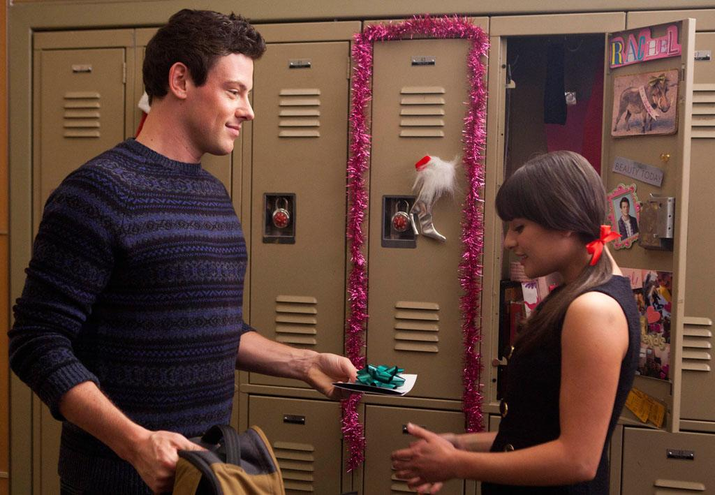 "Finn (Cory Monteith) gives Rachel (Lea Michele) a gift in the ""Extraordinary Merry Christmas"" episode of ""Glee."""