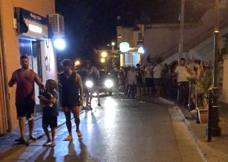 People walk on a street after an earthquake hit the island of Ischia, off the coast of Naples, Italy August 21, 2017. MANDATORY CREDIT @totoriellos/Handout via Reuters