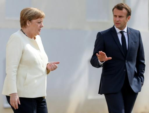 Chancellor Angela Merkel and French President Emmanuel Macron for talks at the German government retreat in Meseberg
