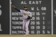 Oakland Athletics' Elvis Andrus throws to first to retire Boston Red Sox's Rafael Devers in the sixth inning of a baseball game, Thursday, May 13, 2021, in Boston. (AP Photo/Steven Senne)