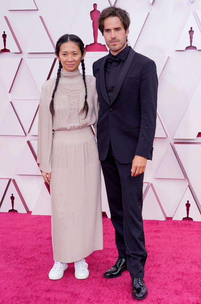 """<p>Chloe Zhao and her partner Joshua James Richards both got nominated for Nomadland, with Zhao<a href=""""https://www.harpersbazaar.com/uk/awards-season/a36225594/chloe-zhao-oscar-best-director/"""" rel=""""nofollow noopener"""" target=""""_blank"""" data-ylk=""""slk:making history as she won for Best Director."""" class=""""link rapid-noclick-resp""""> making history as she won for Best Director. </a></p>"""