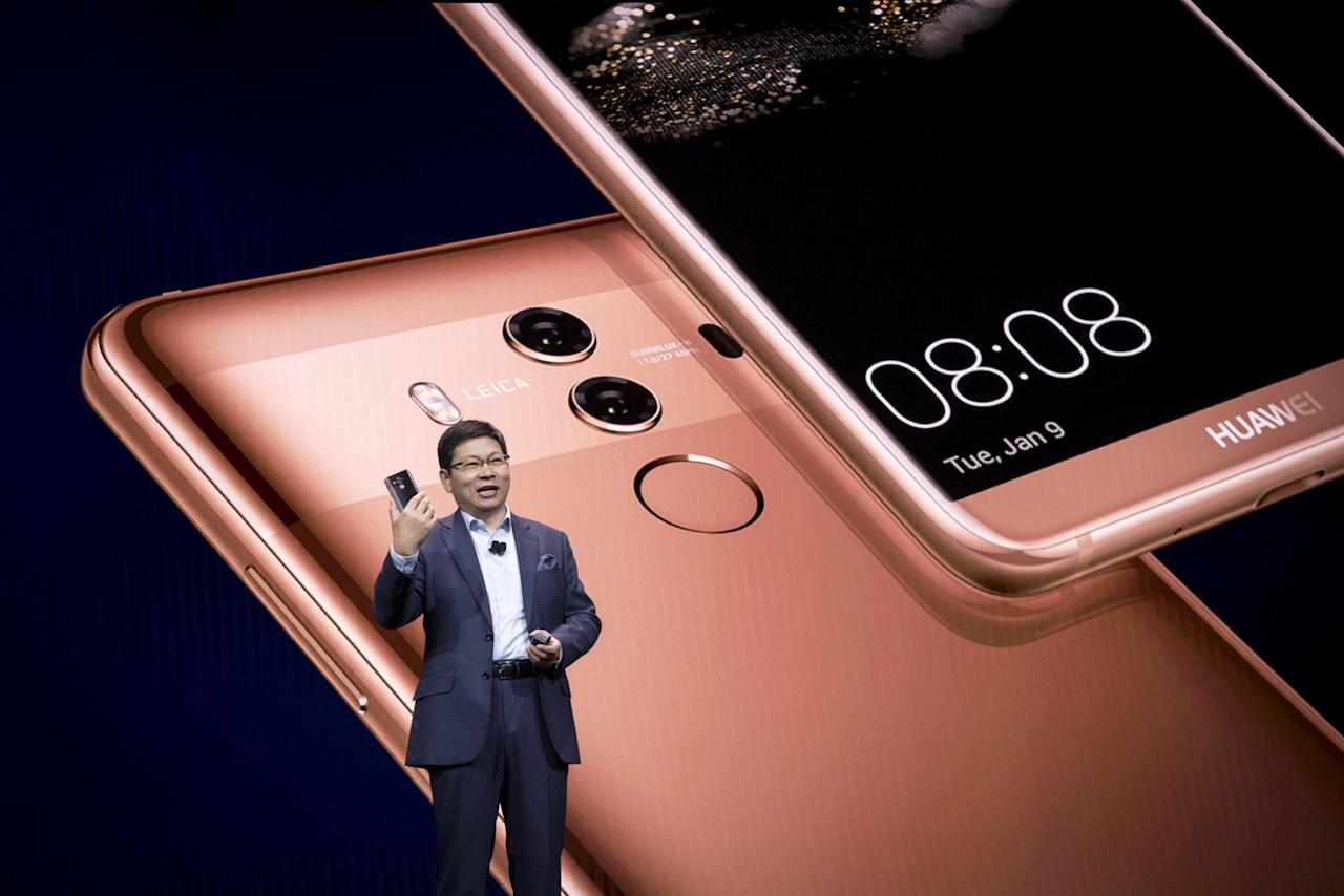 Richard Yu, chief executive officer of Huawei Technologies Co., holds the Mate 10 Pro smartphone while speaking during the company's keynote event at the 2018 Consumer Electronics Show (CES) in Las Vegas, Nevada, U.S., on Tuesday, Jan. 9, 2018. Electric and driverless cars will remain a big part of this year's CES, as makers of high-tech cameras, batteries, and AI software vie to climb into automakers' dashboards. Photographer: David Paul Morris/Bloomberg via Getty Images