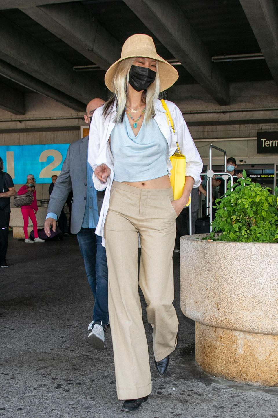 """<h1 class=""""title"""">Celebrity Sightings At Nice Airport - The 74th Annual Cannes Film Festival</h1><cite class=""""credit"""">Photo: Getty Images</cite>"""