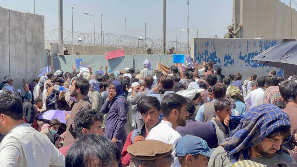 Afghan people who want to leave the country continue to wait around Hamid Karzai International Airport in Kabul, Afghanistan on August 26, 2021. (Haroon Sabawoon/Anadolu Agency via Getty Images)
